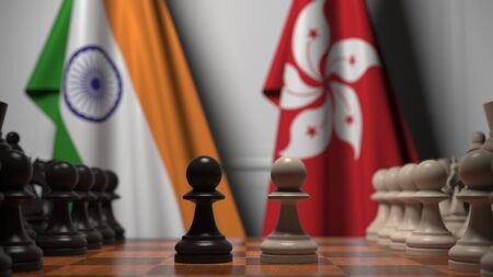 Flags of India and Hong Kong behind pawns on the chessboard. Chess game or political rivalry related 3D rendering