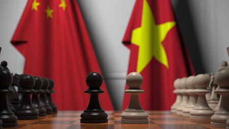 Flags of China and Vietnam behind pawns on the chessboard. Chess game or political rivalry related 3D rendering