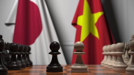 Flags of Japan and Vietnam behind pawns on the chessboard. Chess game or political rivalry related 3D rendering Stock Photo