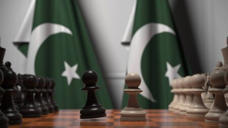 Flags of Pakistan behind pawns on the chessboard. Chess game or political rivalry related 3D rendering