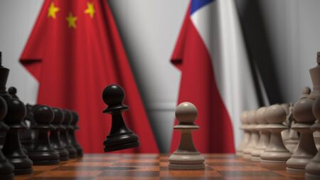 Flags of China and Chile behind pawns on the chessboard. Chess game or political rivalry related 3D rendering Фото со стока