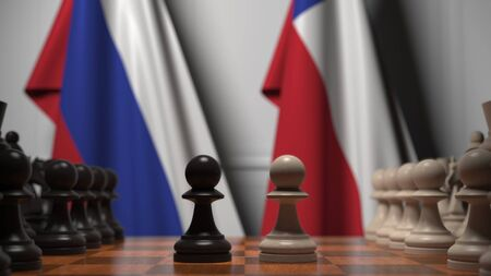 Flags of Russia and Chile behind pawns on the chessboard. Chess game or political rivalry related 3D rendering Фото со стока