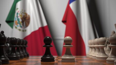 Flags of Mexico and Chile behind pawns on the chessboard. Chess game or political rivalry related 3D rendering