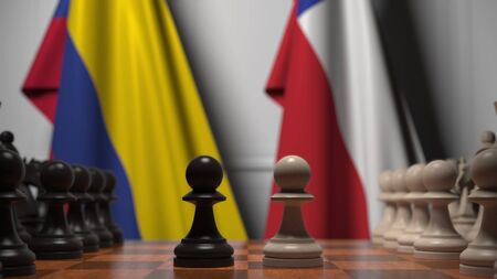 Flags of Colombia and Chile behind pawns on the chessboard. Chess game or political rivalry related 3D rendering