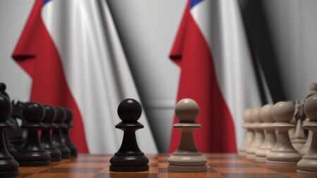 Flags of Chile behind pawns on the chessboard. Chess game or political rivalry related 3D rendering
