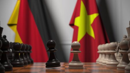 Flags of Germany and Vietnam behind pawns on the chessboard. Chess game or political rivalry related 3D rendering Stock Photo