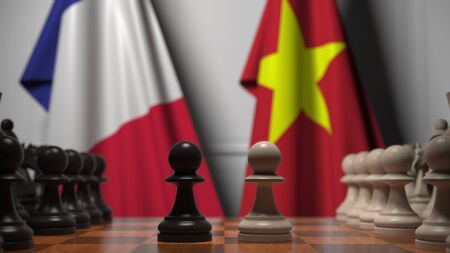 Flags of France and Vietnam behind pawns on the chessboard. Chess game or political rivalry related 3D rendering