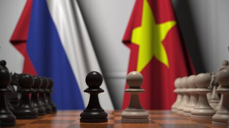 Flags of Russia and Vietnam behind pawns on the chessboard. Chess game or political rivalry related 3D rendering