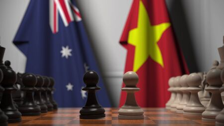 Flags of Australia and Vietnam behind pawns on the chessboard. Chess game or political rivalry related 3D rendering