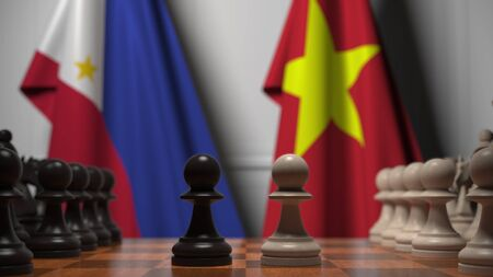 Flags of Philippines and Vietnam behind pawns on the chessboard. Chess game or political rivalry related 3D rendering