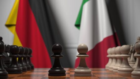 Chess game against flags of Germany and Italy. Political competition related 3D rendering 免版税图像