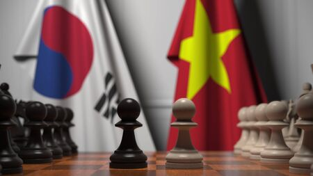 Flags of South Korea and Vietnam behind pawns on the chessboard. Chess game or political rivalry related 3D rendering