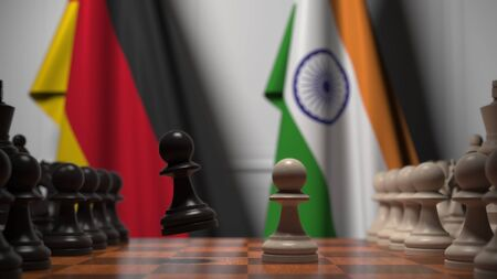 Chess game against flags of Germany and India. Political competition related 3D rendering
