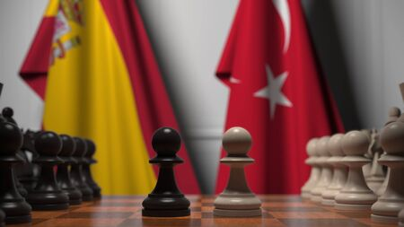 Chess game against flags of Spain and Turkey. Political competition related 3D rendering