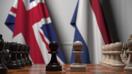 Chess game against flags of Great Britain and Netherlands. Political competition related 3D rendering Stock Photo