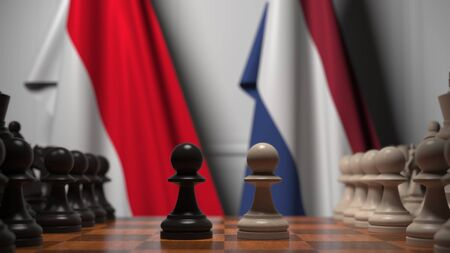 Chess game against flags of Indonesia and Netherlands. 3D rendering Stock Photo