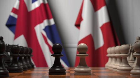 Chess game against flags of Great Britain and Switzerland. Political competition related 3D rendering Stock Photo