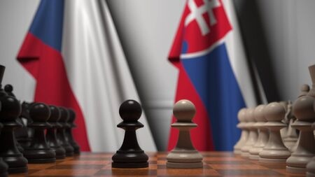 Flags of the Czech Republic and Slovakia behind pawns on the chessboard. Chess game or political rivalry related 3D rendering 免版税图像