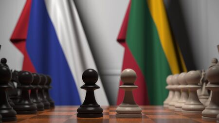 Flags of Russia and Lithuania behind pawns on the chessboard. Chess game or political rivalry related 3D rendering