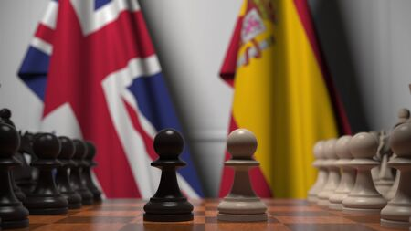 Chess game against flags of Great Britain and Spain. Political competition related 3D rendering Stock Photo