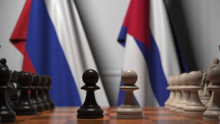 Flags of Russia and Cuba behind pawns on the chessboard. Chess game or political rivalry related 3D rendering