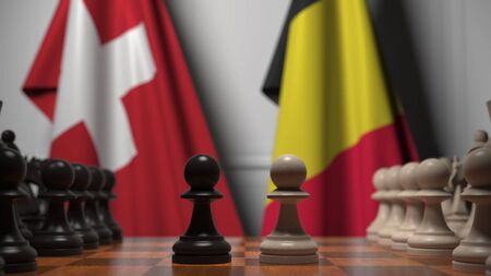 Bandiere della Svizzera e del Belgio dietro le pedine sulla scacchiera. Rendering 3D relativo al gioco degli scacchi o alla rivalità politica