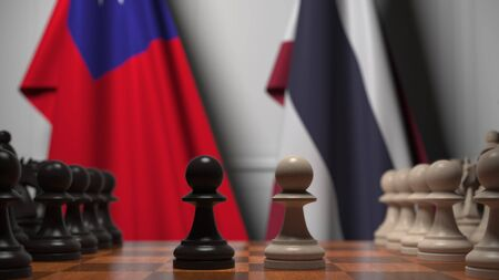 Flags of Taiwan and Thailand behind pawns on the chessboard. Chess game or political rivalry related 3D rendering