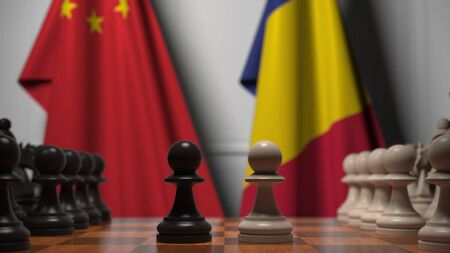 Flags of China and Romania behind pawns on the chessboard. Chess game or political rivalry related 3D rendering