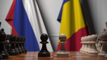 Flags of Russia and Romania behind pawns on the chessboard. Chess game or political rivalry related 3D rendering