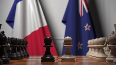 Flags of France and New Zealand behind pawns on the chessboard. Chess game or political rivalry related 3D rendering