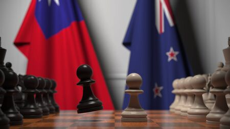 Flags of Taiwan and New Zealand behind pawns on the chessboard. Chess game or political rivalry related 3D rendering Imagens