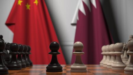 Flags of China and Qatar behind pawns on the chessboard. Chess game or political rivalry related 3D rendering Stock Photo