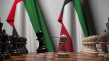 Flags of UAE and Kuwait behind pawns on the chessboard. Chess game or political rivalry related 3D rendering Imagens
