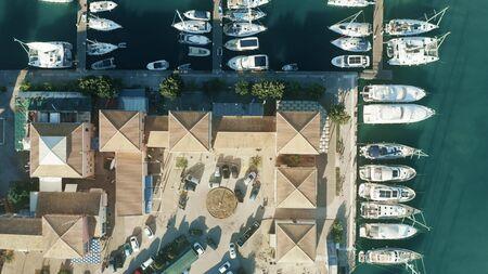 Aerial top down shot of a Greek marina and sailboats