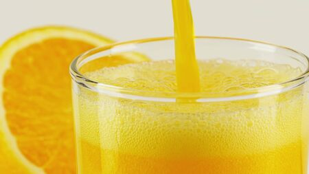 Pouring orange soft drink into glass, close-up shot Stok Fotoğraf