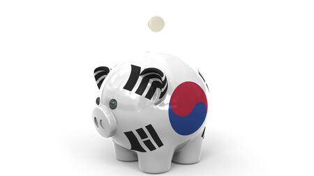 Coins fall into piggy bank painted with flag of South Korea. National banking system or savings related conceptual 3D rendering