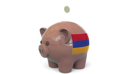 Putting money into piggy bank with flag of Armenia. Tax system system or savings related conceptual 3D rendering 写真素材
