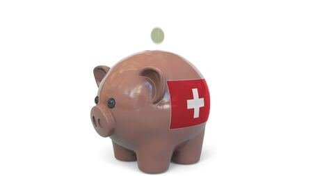 Putting money into piggy bank with flag of Switzerland. Tax system system or savings related conceptual 3D rendering 写真素材