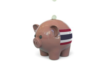 Putting money into piggy bank with flag of Thailand. Tax system system or savings related conceptual 3D rendering