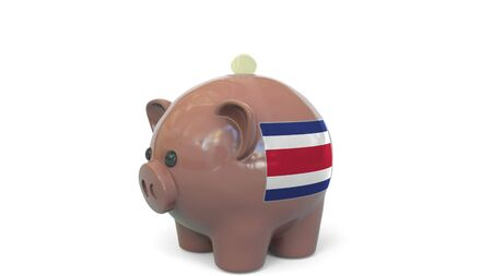 Putting money into piggy bank with flag of Costa Rica. Tax system system or savings related conceptual 3D rendering 写真素材