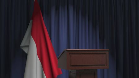 Flag of Indonesia and speaker podium tribune. Political event or statement related conceptual 3D rendering