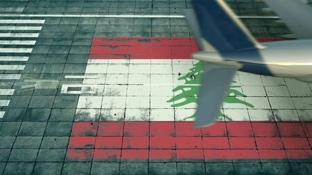 Aerial view of a landing airplane and flag of Lebanon on the airfield of an airport. Air travel related conceptual 3D rendering