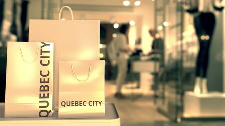 Shopping bags with Quebec city caption against blurred store entrance. Shopping in Canada related 3D rendering