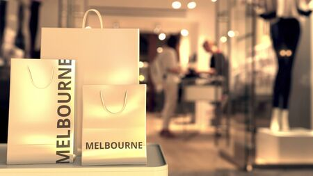 Shopping bags with Melbourne caption against blurred store entrance. Shopping in Australia related conceptual 3D rendering