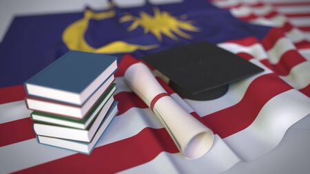 Graduation cap, books and diploma on the Malaysian flag. Higher education in Malaysia related conceptual 3D rendering
