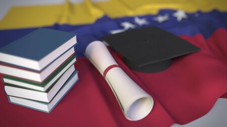 Graduation cap, books and diploma on the Venezuelan flag. Higher education in Venezuela related conceptual 3D rendering