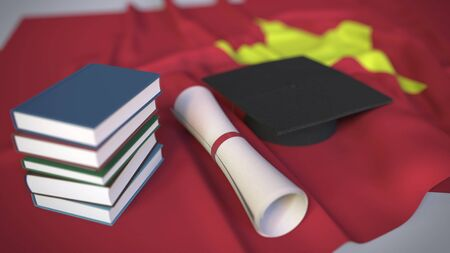 Graduation cap, books and diploma on the Vietnamese flag. Higher education in Vietnam related conceptual 3D rendering