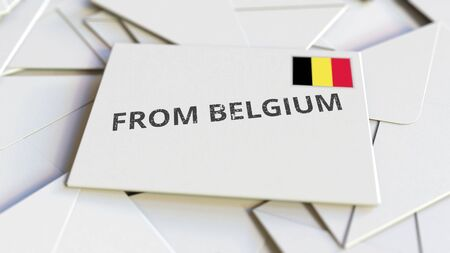 Envelope with From Belgium text on pile of other envelopes. International mail related conceptual 3D rendering 版權商用圖片