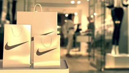 Paper shopping bags with Nike logo. Editorial shopping related 3D rendering
