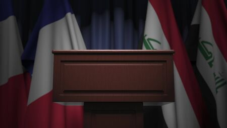Flags of Iraq and France at international meeting, 3D rendering